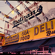 Nathan's Delicatessen has been a fixture in Coney Island, Brooklyn, NY since 1916. Serving footlong hotdogs, and hosting the annual July 4th Hot Dog Eating Contest.