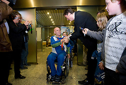Franc Pinter with bronze paraolympic medal accepts congratulations from minister Milan Zver at welcome ceremony at Airport Joze Pucnik, on September 20, 2008, in Brnik, Slovenia. (Photo by Vid Ponikvar / Sportal Images)./ Sportida)