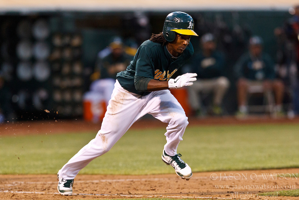 OAKLAND, CA - JUNE 20: Jemile Weeks #19 of the Oakland Athletics runs to first base after an at bat against the Los Angeles Dodgers during the fifth inning of an interleague game at O.co Coliseum on June 20, 2012 in Oakland, California. The Oakland Athletics defeated the Los Angeles Dodgers 4-1. (Photo by Jason O. Watson/Getty Images) *** Local Caption *** Jemile Weeks