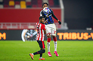 Middlesbrough defender Djed Spence (29) battles for possession in the air with Brentford defender Rico Henry (3) during the EFL Sky Bet Championship match between Brentford and Middlesbrough at Brentford Community Stadium, Brentford, England on 7 November 2020.