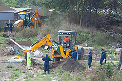 ©Licensed to London News Pictures 10/09/2020  <br /> Orpington, UK. Specialist search team officers on the site with two JCB diggers. Police continue to search a traveller site in Orpington, South East London today after one of the biggest armed police operations in the UK. The site and local roads are under Met police control with a large cordon in place. Photo credit:Grant Falvey/LNP