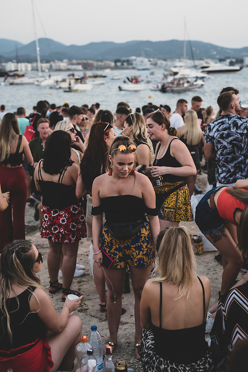 A large crowd of mostly young adults gathers for sunset at the beach on the 'sunset strip' in Sant Antoni (San Antonio), Ibiza. (August 3, 2018)