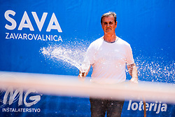 Worker watering the court during Day 2 of tennis tournament Mima Jausovec cup where compete best Slovenian tennis players of the East and West, on June 7, 2020 in RCU Lukovica, Slovenia. Photo by Matic Klansek Velej / Sportida