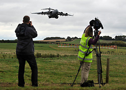 © licensed to London News Pictures. CARTERTON, UK.  08/09/11. The plane carrying the body lands at RAF Brize Norton. The body of Sergeant Barry Weston of 42 Commando Royal Marines is returned to the UK. Sgt Weston was killed on August 30 while leading a patrol near the village of Sukmanda in southern Nahr-e Saraj, Helmand province. Sgt Weston's repatriation is the first to be received at RAF Brize Norton since repatriations ceased to take place at Wootton Basset. Mandatory Credit Stephen Simpson/LNP