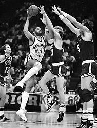 Golden State Warrior Greg Ballard against Boston Celtics Larry Bird and Kevin McHale..(1986 Photo/Ron Riesterer)