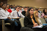 Purchase, NY – 31 October 2014. A faculty advisor from Ossining High School watches the team from Yonkers Montessori present. The Business Skills Olympics was founded by the African American Men of Westchester, is sponsored and facilitated by Morgan Stanley, and is open to high school teams in Westchester County.