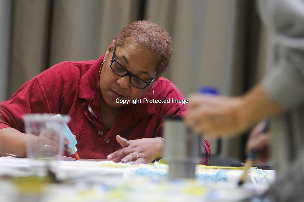 """Althea Johnson, left, and Mary Bryan paint quilt squares during """"Create Your Own Quilt Squares"""" Sunday November 23, 2014 at the Cameron Art Museum in Wilmington, N.C. (Jason A. Frizzelle)"""