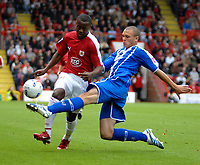 Photo: Ed Godden.<br />Bristol City v Brighton & Hove Albion. Coca Cola League 1. 02/09/2006. Jennison Myrie-Williams (L), is challenged by Brighton's Joel Lynch.