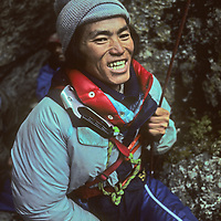 A young Sherpa mountaineer learns proper belay techniques at a climbing school operated by Mountain Travel Nepal in September, 1980.