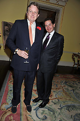 Left to right, LORD VALENTINE CECIL and MIGUEL HOWARD at Ambassador Earle Mack's 60's reunion party held at The Ritz Hotel, London on 18th June 2012.