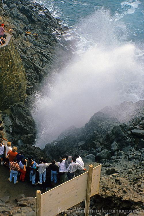 """North America, Mexico, Baja California, Ensenada. Visitors watch La Bufadora, or """"blowhole"""" of the Pacific ocean  on the Baja coast."""