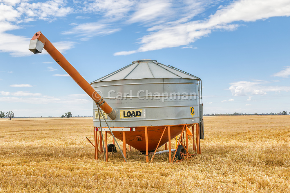 Mobile field bin grain silo in paddock after harvest <br /> <br /> Editions:- Open Edition Print / Stock Image