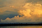 Storm Clouds over rain forest & Amazon river - Amazonia, Peru