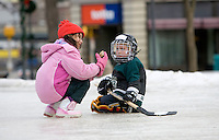 NAUGATUCK, CT- 25 FEB 06- 022507JT04- .Ariana LoCascio, 7, and Brian Parzyck, 5, inspect of a peice of ice which they concluded resembled a pig's ear at the ice skating rink on the Naugatuck Green on Sunday afternoon..Josalee Thrift Republican-American