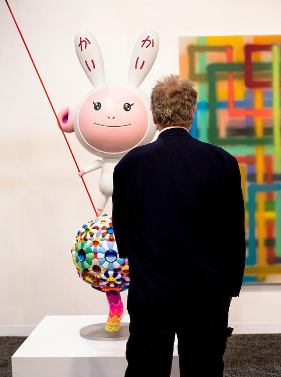 "Visitor meets sculpture ""Kaikai Kiki"" by Takashi Murakami at Galerie Emmanuel Perotin, Art Basel Miami Beach 2007"