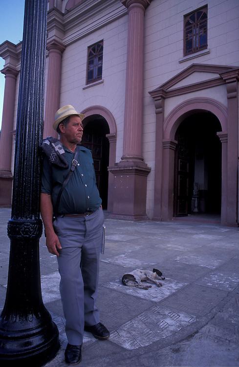 Resident of El Retiro in front of church