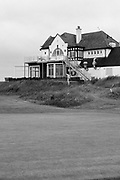 Looking across the 18th Green at Hunstanton Golf Club. A golfer walks back up to the clubhouse.<br /> <br /> Photo by Jonathan J Fussell, COPYRIGHT 2021