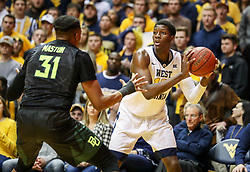 Jan 9, 2018; Morgantown, WV, USA; West Virginia Mountaineers forward Lamont West (15) looks to pass during the second half against the Baylor Bears at WVU Coliseum. Mandatory Credit: Ben Queen-USA TODAY Sports