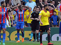 Football - 2017 / 2018 Premier League - Watford vs. Crystal Palace<br /> <br /> Wilfried Zaha of Palace can't believe he has been booked for diving by Referee, Chris Kavanagh  at Vicarage Road.<br /> <br /> COLORSPORT/ANDREW COWIE