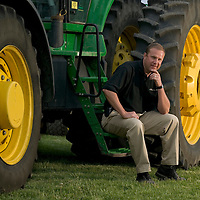 Cargill AgSolutions manager poses for an evening portrait with a tractor outside of Lafayette, Indiana.