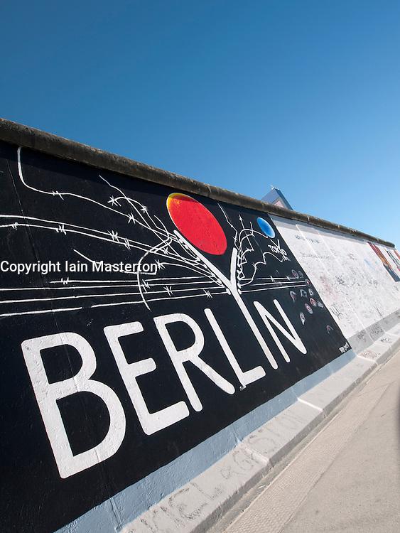 paintings on Berlin Wall at East Side Gallery in Berlin Germany