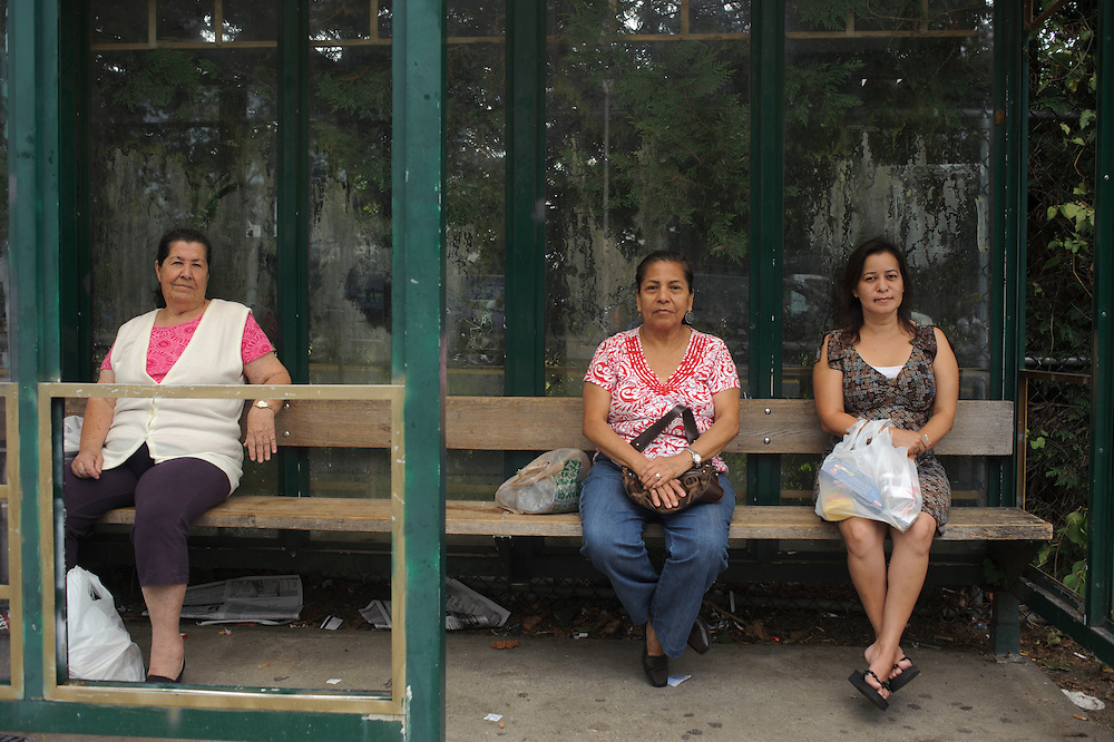 Maria Gomez from Colombia wait for the bus 3B, Victoria Macías from Venezuela wait for the bus S45 and Marylu Quintanilla from El Salvador wait for the bus 3B at the Bus Stop near the Train Station in Brentwood. (July. 19, 2012)