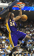 Los Angeles Lakers guard Kobe Bryant dunks the ball during the first half of their NBA basketball game against the Orlando Magic in Orlando, Florida.