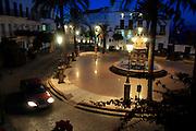 Street lights illuminating Plaza de Espana, Vejer de la Frontera, Cadiz Province, Spain