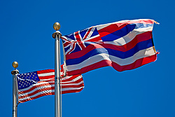 flags of the United States of America and the State of Hawaii at the entrance of Puukohola Heiau National Historic Site, Kawaihae, Kohala, Big Island, Hawaii, USA