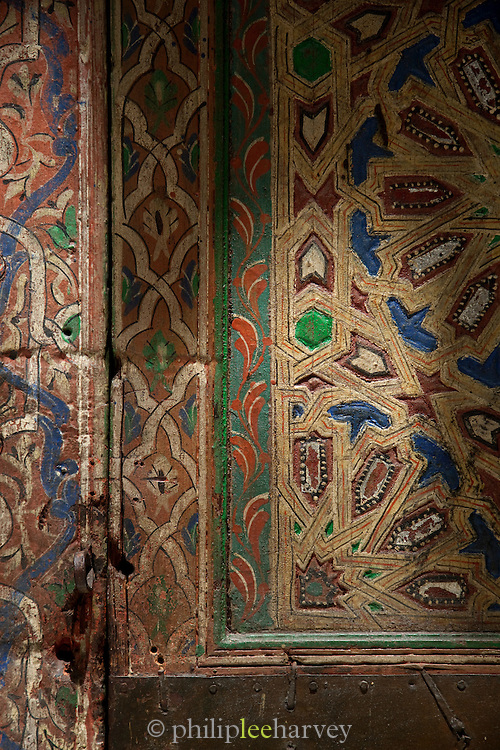 An antique painted, wooden door in the medina of Fes, Morocco