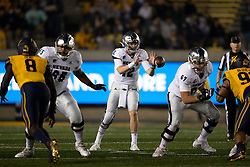 Nevada quarterback Carson Strong (12) takes the snap during the second quarter of an NCAA college football game against California, Saturday, Sept. 4, 2021, in Berkeley, Calif. (AP Photo/D. Ross Cameron)