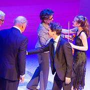 NLD/Amsterdam/20151123 - 5 jaar Delamar theater en 10 Jaar Van den Ende Foundation viering, violiste Noa Wildschut en Joop van den Ende en partner Janine Klijburg
