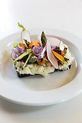 Smorrebrod cod fish Nordic open sandwich on minimalist white china <br /> in Denmark