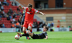 Leyton Orient's Romain Vincelot is fouled by Walsall's James Baxendale - photo mandatory by-line David Purday JMP- Tel: Mobile 07966 386802 23/08/14 - Leyton Orient v Walsall - SPORT - FOOTBALL - Sky Bet Leauge 1 - London -  Matchroom Stadium