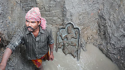 August 1, 2018 - Agartala, Tripura, India - A 2.5 feet high and 1.5 feet wide statue of a Hindu Goddess, made of stone, was discovered when some labourers were digging soil to construct a pandal at Udaipur in Tripura's Gomati district. (Credit Image: © Abhisek Saha/SOPA Images via ZUMA Wire)