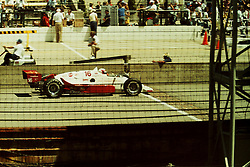 Indianapolis Time Trials, May 1987<br /> #16 - Tony Bettenhausen Jr.<br /> <br /> A scan from an old photo or slide from the collection of Alan and Becky Look dated 1987 and 1988.