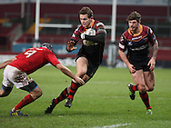 Hallam Amos of the Newport Gwent Dragons makes a break from Duncan Willams of Munster.<br /> Guinness Pro12 rugby match, Munster v Newport Gwent Dragons at Thomond Park in Limerick , Ireland on Saturday 5th March 2016.<br /> pic by  John Halas, Andrew Orchard sports photography.