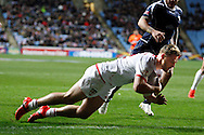 England's Elliott Whitehead (12 Canberra Raiders) goes over to score England's first try during the Ladbrokes Four Nations match between England and Scotland at the Ricoh Arena, Coventry, England on 5 November 2016. Photo by Craig Galloway.