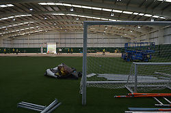 Discarded sports equipment as workers lay flooring during the construction of a field hospital, which will hold up to 340 beds for coronavirus patients, at Llandarcy Academy of Sport, Neath, as the health services in the Swansea Bay area prepare their response to the coronavirus outbreak.