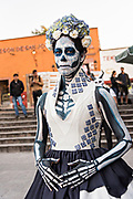 A young Mexican woman dressed in La Calavera Catrina costume for the Day of the Dead or Día de Muertos festival October 29, 2017 in San Miguel de Allende, Guanajuato, Mexico. The festival has been celebrated since the Aztec empire celebrates ancestors and deceased loved ones.