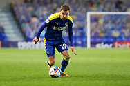 AFC Wimbledon attacker Shane McLoughlin (19) dribbling during the EFL Sky Bet League 1 match between AFC Wimbledon and Lincoln City at Plough Lane, London, United Kingdom on 2 January 2021.