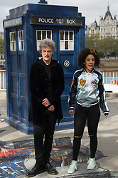 Actor Peter Capaldi who plays Dr Who and actress Pearl Mackie who plays new companion Bill Potts stand on 3D Alien Landscape painting to celebrate new TV series of Dr Who.