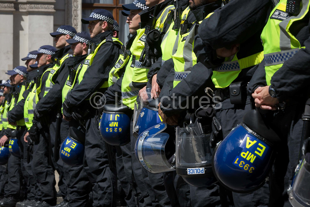 A week after a Black Lives Matter protest turned to violence when the statue of wartime Prime Minister Sir Winston Churchill was daubed in graffiti which called him a racist, and despite warning from police not to attend protests at all today - and to be off the streets by 5.00pm - a large group crowd of right-wing groups and veterans gathered at the boxed-in statue to protect it from further vandalism by Black Lives Matter and anti-racism protesters. Riot police stopped the right-wing groups from proceeding up Whitehall where the Cenotaph was also behind a screen, resulting in scuffles, on 13th June 2020, in London, England.
