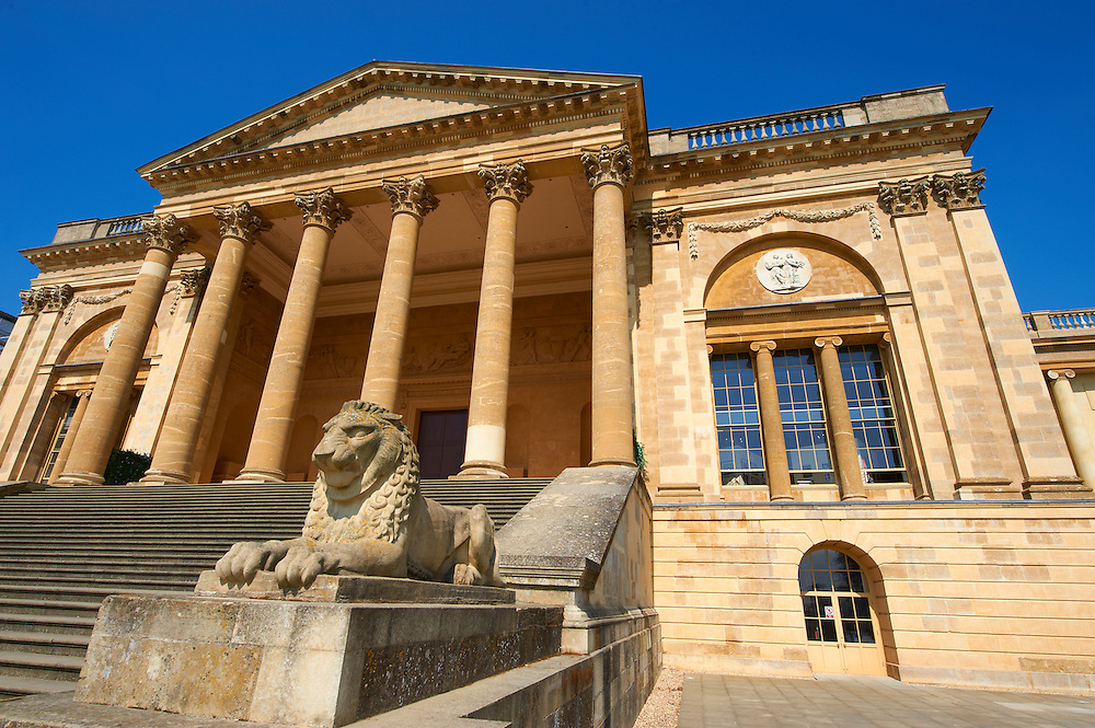 Lion statue in front of the neo-classic south front with Corinthian columns of the Duke of Buckingham's  Stowe House designed by Robert Adam in 1771,  Buckingham, England .<br /> <br /> Visit our EARLY MODERN ERA HISTORICAL PLACES PHOTO COLLECTIONS for more photos to buy as wall art prints https://funkystock.photoshelter.com/gallery-collection/Modern-Era-Historic-Places-Art-Artefact-Antiquities-Picture-Images-of/C00002pOjgcLacqI