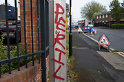 Graffiti of the word Peril in Highgate, the inner city area of Birmingham which is virtually deserted under Coronavirus lockdown on 29th April 2020 in Birmingham, England, United Kingdom. Coronavirus or Covid-19 is a new respiratory illness that has not previously been seen in humans. While much or Europe has been placed into lockdown, the UK government has put in place more stringent rules as part of their long term strategy, and in particular social distancing.
