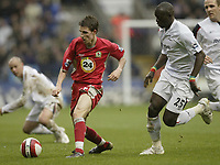 Photo: Aidan Ellis.<br /> Bolton Wanderers v Blackburn Rovers. The Barclays Premiership. 04/03/2007.<br /> Blackburn's Matt Derbyshire (L) and Bolton's Abdoulaye Faye