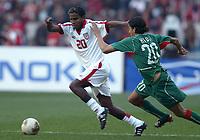 Fotball<br /> African Nations Cup 2004<br /> Afrika mesterskapet 2004<br /> Foto: Digitalsport<br /> NORWAY ONLY<br /> <br /> FINAL - 040214 <br /> TUNISIA v MOROCCO <br /> JOSE CLAYTON (TUN) / YOUSSOUF  HADJI (MAR) *** Local Caption *** 40001044