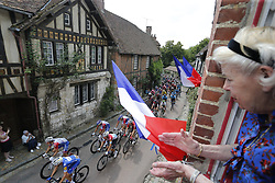 July 14, 2018 - Amiens, France - French flags fly and supporters cheer as the peloton passes through Amiens during stage 8 of the 105th edition of the 2018 Tour de France cycling race, a stage of 181 kms between Dreux and Amiens Metropole. (Credit Image: © Panoramic via ZUMA Press)