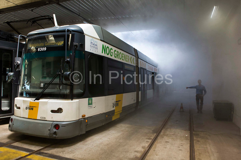 Patrick De Boeuf, Chief Executive of De Lijn, demonstrates the loss of heat from trams with a smoke machine in the tram depot in Ghent, Belgium.  He has modernized the public transport tramcars with innovative technology to reduce electricity consumption and has won a prestigious Ashden sustainable travel award for this work.
