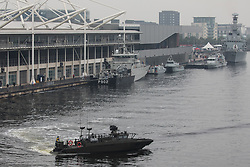London, UK. 14th September, 2021. Saab demonstrates a CB90 Next Generation (CB90 NG) fast assault craft at Royal Victoria Dock alongside ExCeL London on the first day of the DSEI 2021 arms fair. Activists from a range of different groups have been protesting outside the venue for one of the world's largest arms fairs for over a week.
